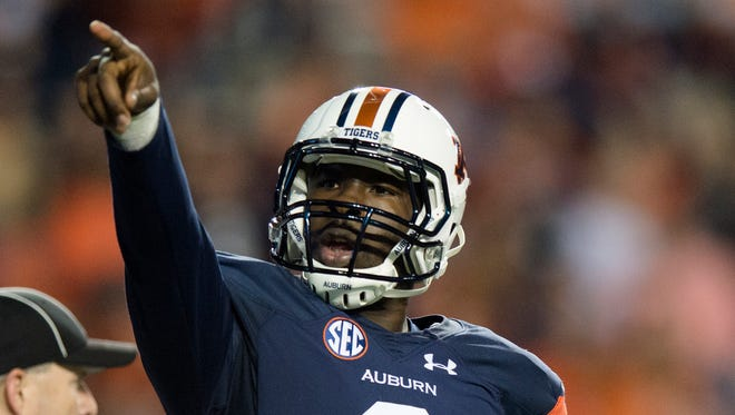 Auburn Tigers quarterback Jeremy Johnson (6) points towards the ROTC section after scoring a touchdown during the NCAA football game between Auburn and Idaho on Saturday, Nov. 21, 2015, at Jordan-Hare Stadium in Auburn, Ala.