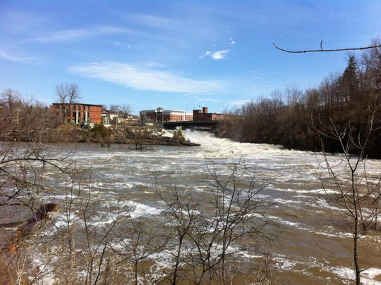 The same view as the historic photo above of the Winooski