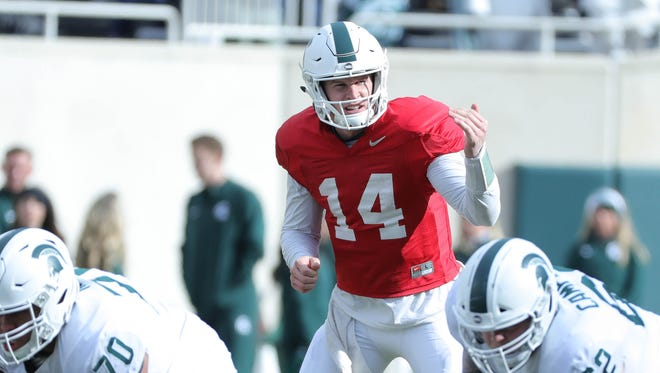 Michigan State quarterback Brian Lewerke runs the offense during the annual spring game Saturday, April 7, 2018 at Spartan Stadium.