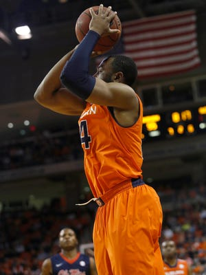 Auburn's Antoine Mason shoots a 3-pointer against Ole Miss on Saturday in Auburn. Mason led the Tigers with 23 points in the loss.
