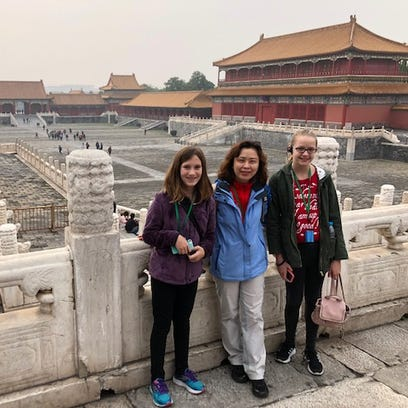 Sun Ye (center), the Chinese language teacher at Jefferson