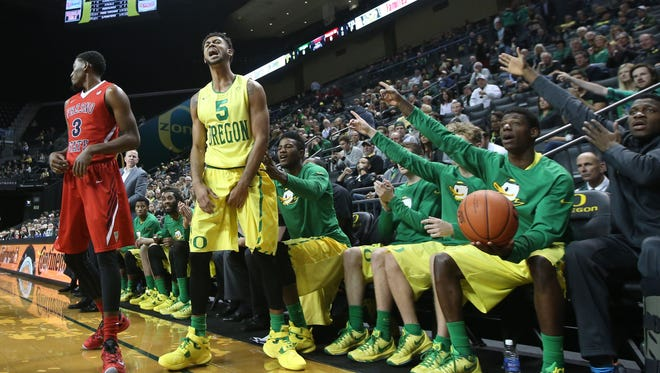Oregon's Tyler Dorsey, center, let out a celebratory yell as an out of bounds calls goes to the Ducks during first half of an NCAA college basketball game against Fresno State Monday, Nov. 30, 2015, in Eugene, Ore.