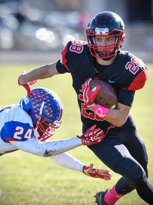 Rocori's Matt Koshiol rushes with the ball during an Oct. 28 game at Rocori High School in Cold Spring. Koshiol, who rushed for more than 1,000 yards and 10 TDs last season, has verbally committed to play football for the University of North Dakota.