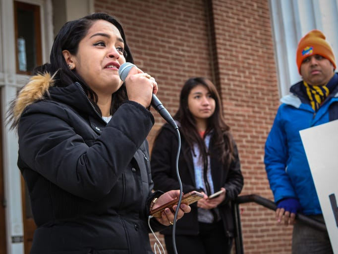 Evelin Salgado cries while addressing the crowd  local