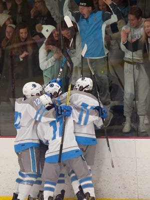 South Burlington players celebrate a goal in front of their fans during Saturday's CSB Cup boys hockey game at Cairns Arena in South Burlington.