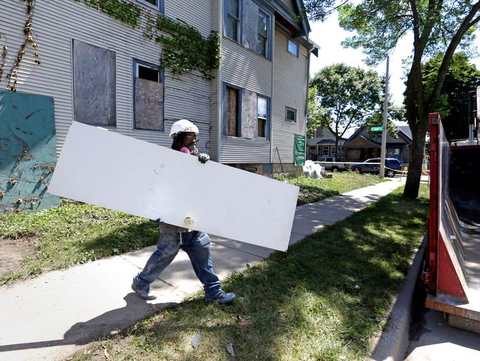 Anthony Boone, who is studying HVAC at MATC, removes