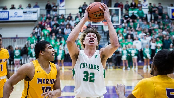 New Castle's Mason Gillis attacks the basket against Marion in their regional championship game at Marion High School Saturday, March 10, 2018.