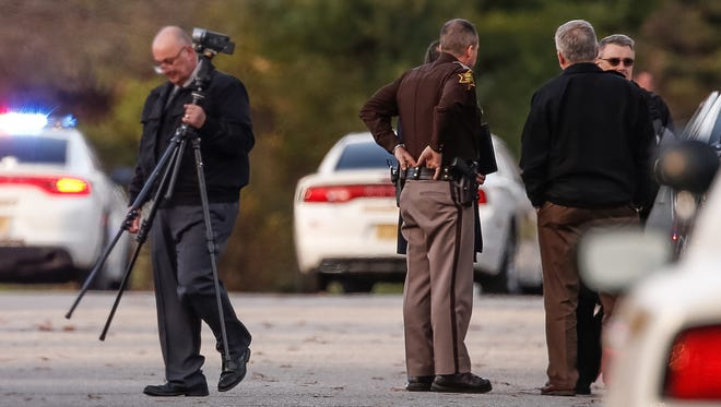 The Hendricks County Sheriff's Office investigates the scene of a reported officer-involved shooting that left one dead Tuesday, Nov. 29, 2016.