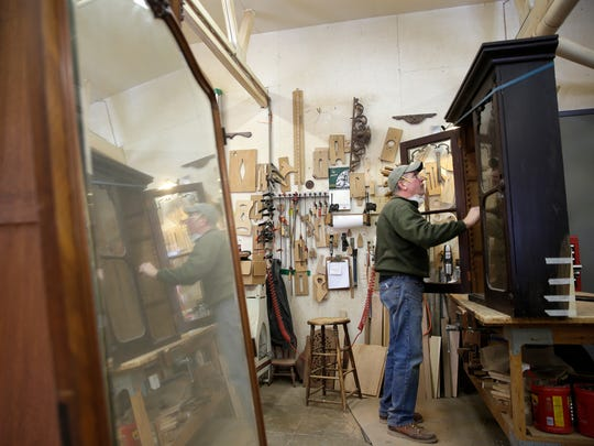 Jim Larson, a carpenter with The Harp Gallery in the