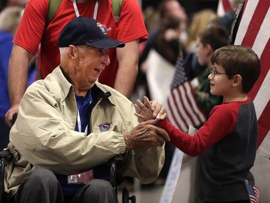 Alvin Cheslock, a WWII veteran from Pulaski, shakes