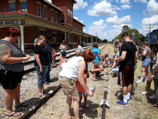 Participants place eggs to fry on the railroad tracks during the Hobo Day celebration at the Railway Museum of San Angelo on Saturday, July 30, 2016.