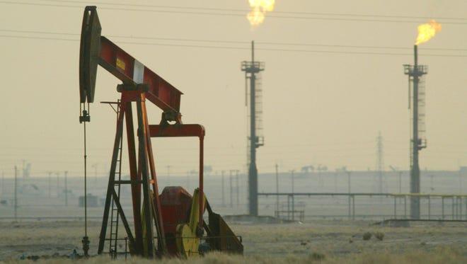 A derek pumps in a oil field near the Saudi Arabian border, Kuwait.