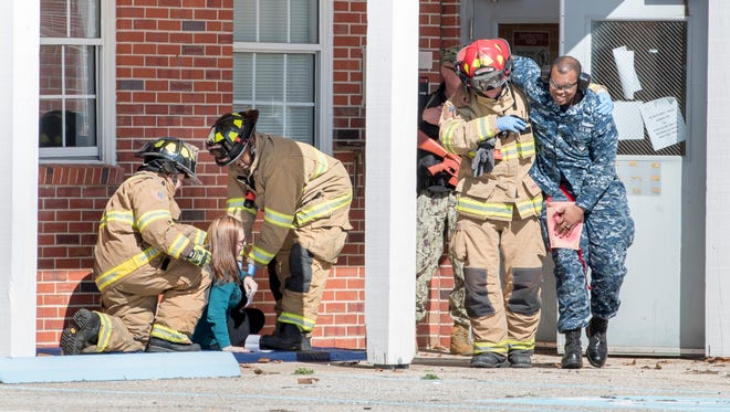 First responders conduct an active shooter and hostage training exercise Wednesday, Jan. 31, 2018, at Pensacola Naval Air Station. Exercise Solid Curtain-Citadel Shield was conducted at naval installations across the country.