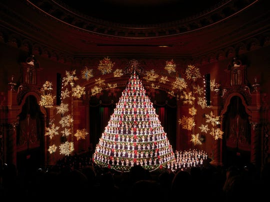Mona Shores choir students perform during the annual Singing Christmas Tree at the Frauenthal Center in Muskegon on Thursday. The Mona Shores Singing Christmas Tree combines the usual elements into an unusual show that will draw thousands of spectators.