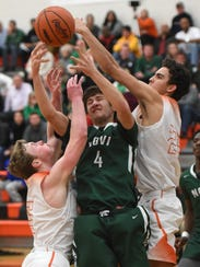 Novi's Alec Begeris (middle) is pressured by Northville's