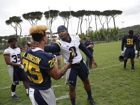 Michigan football players Nate Johnson and Rashan Gary goof around as they wrap up their first day of practice in Rome at Giulio Onesti Training Center on Thursday, April 27, 2017.
