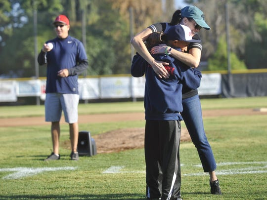 Mary Beth Tippit and Isaac Esquivel, 10, embrace during the 2nd Annual Jayce Tippit Memorial Baseball Tournament.