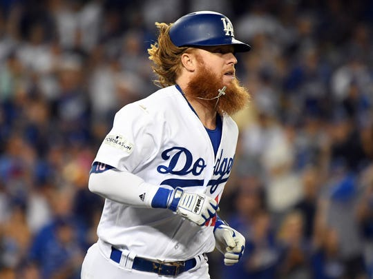 October 6, 2017; Los Angeles, CA, USA; Los Angeles Dodgers third baseman Justin Turner (10) runs after hitting an RBI single in the eighth inning against the Arizona Diamondbacks in game one of the 2017 NLDS at Dodger Stadium. Mandatory Credit: Richard Mackson-USA TODAY Sports