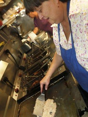 Cherri Brown cooks up an order at Helen's Kitchen in 2011.