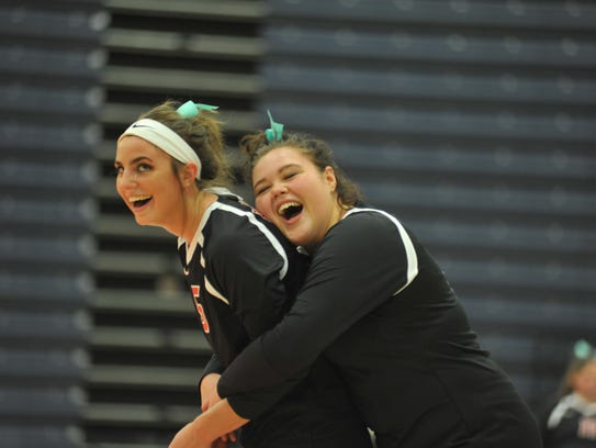 Seniors Shaina Orewiler and Kiana Zehner share a laugh during the sectional championship match.