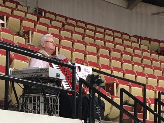 Mike Ashworth and his accordion has been here at World Dairy Expo for 37 years providing favorite tunes from the top level of the stands.