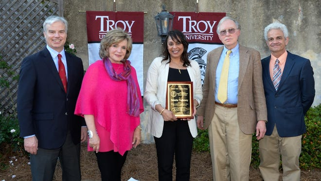 Former U.S. poet laureate Dr. Natasha Trethewey received Troy University's Hall-Waters Prize last week during a reception at the Young House in Montgomery. From left to right, are: Mr. Walter Givhan, Senior Vice Chancellor for Advancement and Economic Development; Mrs. Janice Hawkins, First Lady of Troy University; Trethewey; Mr. Gregg Swem, representing the late Dr. Wade Hall; and, Dr. Kirk Curnutt, chair of the Troy University English Department.