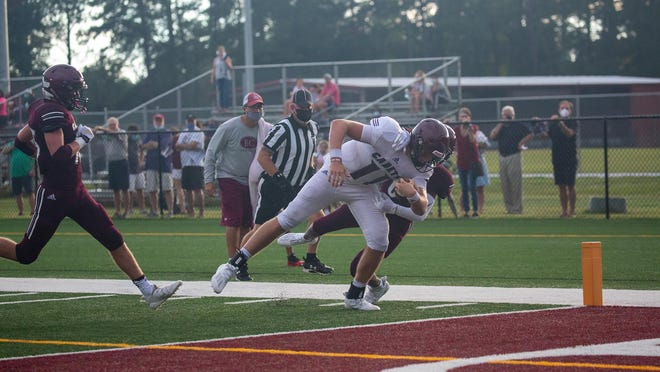 Quarterback Holden Geriner scores a diving touchdown during the Benedictine Maroon vs. White Scrimmage at Father Albert Bickerstaff Field on August 14.