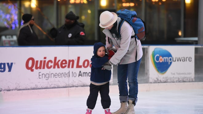 Jane Sugar of Detroit helps her daughter, Thea, 3 1/2 , on the ice during Friday's preseason skating at the rink in Campus Martius Park. The rink's official opening is next weekend, when the downtown Christmas tree will be lighted.