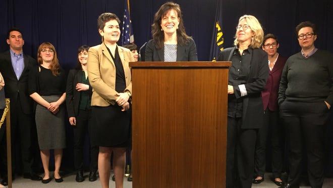 Rep. Karin Power, front left, Sen. Kathleen Taylor and Rep. Alissa Keny-Guyer announce the Oregon Women's Health & Wellness Alliance agenda on Feb. 27, 2017.