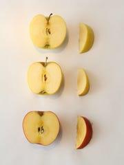 (Top to bottom) A golden delicious apple, an opal apple