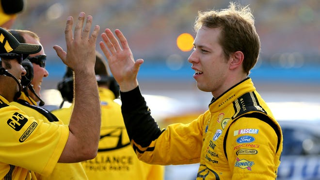 Brad Keselowski celebrates with his crew after winning the pole position during qualifying for the The Profit on CNBC 500 at Phoenix International Raceway.
