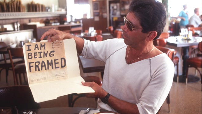 Mark Herman the day he was released from Avon Park Correctional Institution in Sebring when the governor commuted his sentence to time served. He holds the sign he carried at his first time in court.