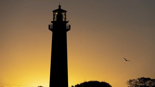 The sun rises behind the Jupiter Inlet Lighthouse, Feb. 19, 2018 in Jupiter, Florida.