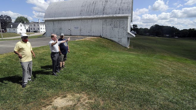 John Bouquet, center, and Manasseh Wakawa, right, of the Ashland County Ministerial Association discuss with Ashland County Park Commissioner Dave McClure on Wednesday the setting up for the Sacred Assembly event at Freer field to be held this Sunday.