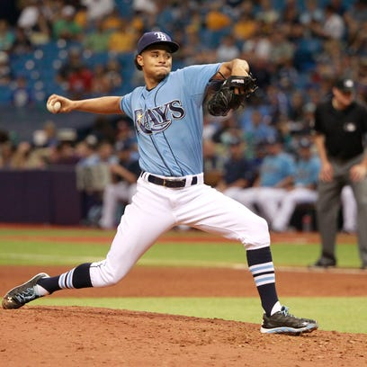 Tampa Bay Rays starting pitcher Chris Archer (22) throws