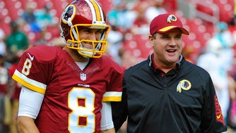 Washington quarterback Kirk Cousins (8) talks with  head coach Jay Gruden before the game between Washington and the Miami Dolphins at FedEx Field.