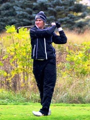 Novi's Maya Grandstaff takes aim in the MHSAA Division 1 Girls Golf Finals at Grand Valley State University's The Meadows.