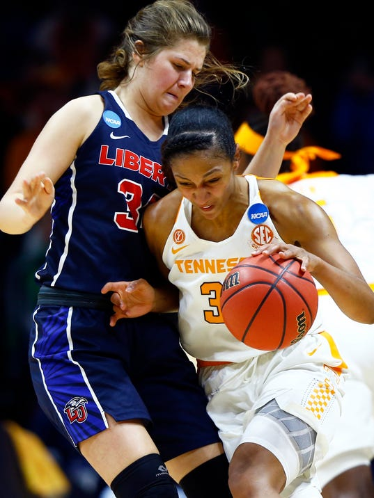 Tennessee forward Jaime Nared (31) drives as she collides with Liberty guard/forward Ola Makurat (35) in the first half of a first-round game in the NCAA college basketball tournament Friday, March 16, 2018, in Knoxville, Tenn. (AP Photo/Wade Payne)