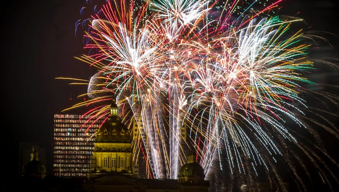 Fireworks light up the sky between the Iowa Capitol and downtown Des Moines, Monday, July 2, 2018, during the DM Symphony's 25th Annual Yankee Doodle Pops concert finale featuring the 1812 Overture with live Howitzer cannons and fireworks.