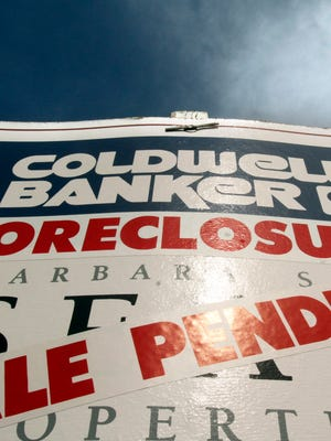 A foreclosure sign outside a house in Tigard, Ore.