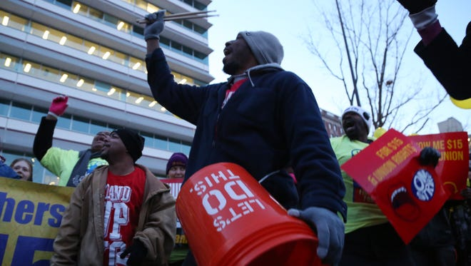 A group of fast-food workers, home care and child care workers, and community supporters protest outside of Capital Square on Thursday, Jan. 28, 2016, before marching to the steps of the Iowa Events Center where the final GOP debate before the Iowa Caucus was being held. The workers were fighting for a higher minimum wage and a union.