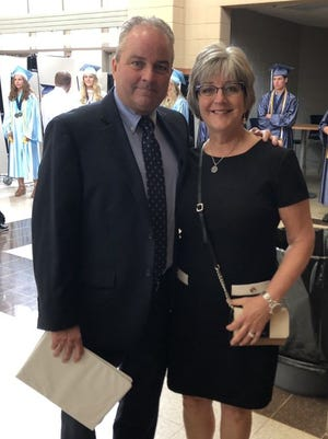 Bay Port principal Mike Frieder, left, stands besides assistant athletic director Suzie Stevens, who is leaving the school.