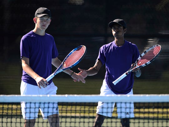 Wylie's Nikhil Kalla and Davyn Williford celebrate their win over Snyder in the boys doubles championship match over Snyder in the District 5-4A tennis tournament on Thursday, April 6, 2017, at Hardin-Simmons University's Streich Tennis Center.