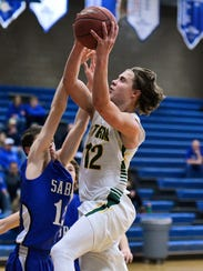 Sauk Rapids' Tyler Kranz (12) goes in for a layup over