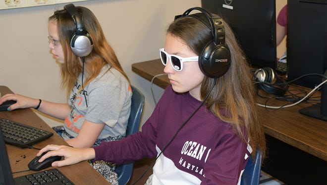Jennie F. Snapp students participate in a coding activity as a part of the 'Made with Code' event.