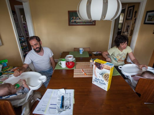 Joe Pagetta and his wife, Keri, feed their 11-month-old