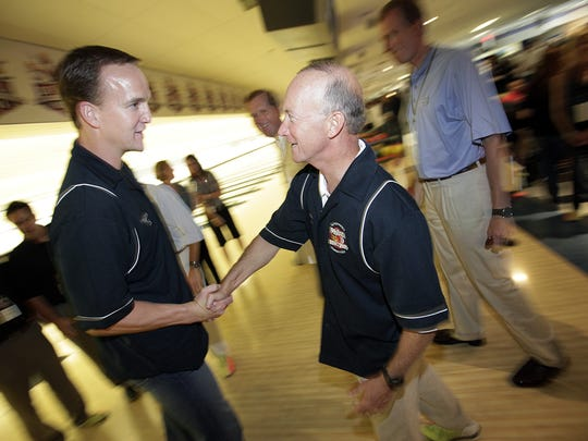 Peyton Manning and Indiana Governor Mitch Daniels talk at Manning's annual PeyBack Bowl at Woodland Bowl in 2004.