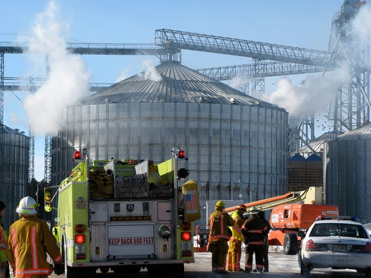 Smoke pours from holes in a grain bin in Brokaw after an explosion in January 2011. The Brokaw facility was among those owned and operated by WI Rapids Grain at the time.