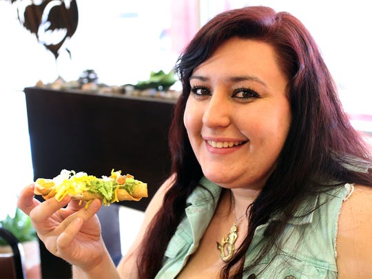 Regular customer Alison Snyder enjoys a five rolled-taco supreme plate at Rivas Taco Shop at 1342 N. Zaragoza Road. It includes 3 ounces of carne asada, sour cream, guacamole and cheese topped with lettuce and pico de gallo.