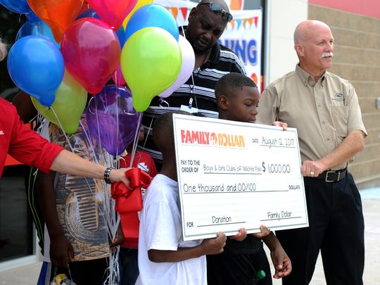Family Dollar presented the Boys and Girls Club of Wichtia Falls a $1,000 check Saturday, Aug. 12, 2017, during the grand opening of the Family Dollar on Martin Luther King Blvd.